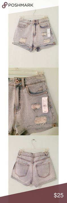 """High Waisted """"Mom Shorts"""" These shorts are a must have! They are high waisted. The light colored wash and rips give them a very vintage look! Worn only to try on and model. Still has tag on it! Perfect condition :) Bullhead Shorts Jean Shorts"""