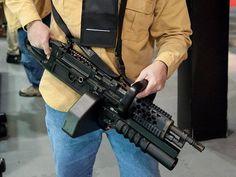 Chainsaw light machine gun by Knight's Armament. (laser sight) and i still need a folding butt stock!