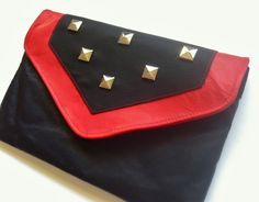 Awesome combination of colors and metal.  (Black and Red Leather Clutch with Studs by som and tooby)