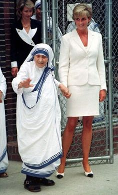 18 June 1997: Diana holds hands with Mother Teresa, the foundress of the Missionaries of Charity, as the two emerge after a brief meeting at the Missionaries of Charity's residence in the Bronx section of New York