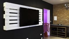 Pallet TV wall unit - this would be great in a rec room of family room!