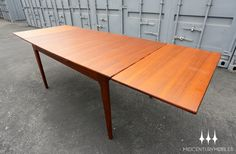 Mid century modern draw leaf dining table in teak by Younger of England.