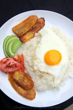 """""""Love in the Time of Cholera"""" Arroz con huevo, or rice with a fried egg, is the ultimate Latin lazy lunch. Can also add fried plantains, avocado, and tomato onion curtido salsa. Colombian Cuisine, Colombian Recipes, Boricua Recipes, Puerto Rico Food, Dominican Food, Dominican Recipes, Spanish Dishes, Spanish Food, Cooking Recipes"""