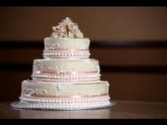 This is the same method that professionals use to make wedding cakes.The best thing about this method is that you can use it to decorate ANY cake you wish! You can also make your owns designs using the icing/Frosting. Once more, this tutorial can be used on any type of cake! Weddings, Birthdays, Anniversarys y...