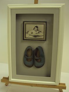 First pair of shoes framed with photo of the original wearer.  These were in a box in the loft for years and now look stunning on the wall.