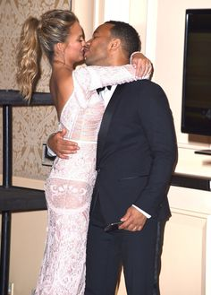 Pin for Later: Love Was in the Air: 40 Sweet, Sexy Celebrity PDA Pictures From 2015 Chrissy Teigen and John Legend