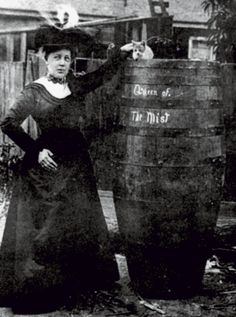 """1901:  In search of fame and fortune, a sixty-three-year-old retired dancing instructor named Annie Edson Taylor becomes the first person ever to plunge over Niagara Falls in a barrel and survive. Upon recovering from her concussion, she tells reporters, """"If it was my dying breath, I would caution anyone against attempting the feat."""""""