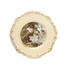 A Spode plate, circa 1825-30 Finely painted with a titled scene of 'OTTER HUNTING', with three male figures by a river bank holding Otters above their heads, with ready hounds at their feet, the ivory coloured ground with a gilt scroll rim