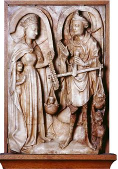 An alabaster image of St Michael weighing souls, while the Virgin Mary, protecting a soul beneath her cloak, lays her rosary on the scale to weight it in favour of a good soul, while to the right a devil tries to pull down the ugly and bad soul. An alabaster probably produced in Nottingham during 15th century.