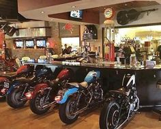 Bar with motorcycle seats
