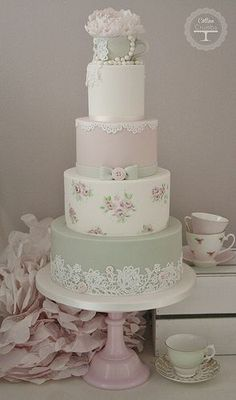 Tea Cup #Wedding Cake Tracy James Cotton and Crumbs Love the lace and buttons on the bottom tier #WeddingEngine