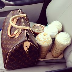 My two favorite things in the passenger seat: Louis Vuitton and Starbucks.