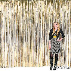 $16 fringe photo booth backdrop (put over white plastic tablecloths & add the fringe neutral garland)