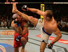 Junior dos Santos kicks Mark Hunt in the face during their heavyweight bout at UFC 160