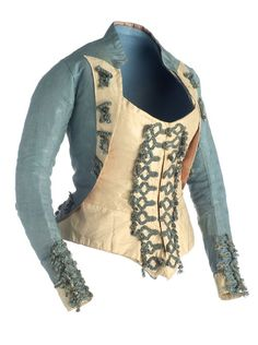 Vest, ca. 1770, Madrid. Blue silk and taffeta silk in ivory. With neck placket and long sleeves and narrow. The back ends in its lower edge in a queue. Decorated with a silk cord application and metallic threads in gold silk braid. Majismo costume, part of the movement in late 18thC Spanish clothing away from the influence of the French and towards a more Spanish style of clothing.
