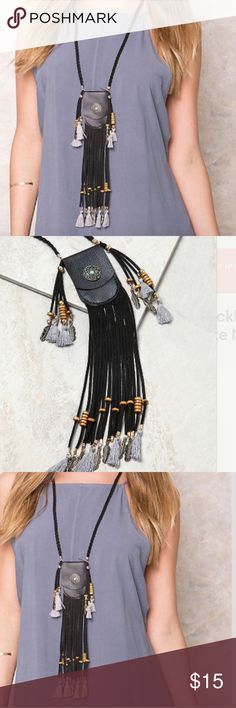 """Tessels boho pounce necklace bag necklace Handmade small faux leather pouch set into open flap. Intricately braided suede neck strap and fringe detailing. Adorned with wood beads hanging fringe, tassels and dream catcher buttons give a vintage inspired feel.  Measures approximately:  24.5"""" inches long Pouch measures 3"""" inches Jewelry Necklaces"""