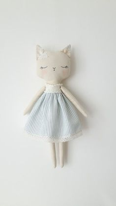 Little Kitty cloth doll made with lots of love and care. This doll is: - handmade from cotton fabric - 16 (41cm) tall from ears to toes. - filled with hypoallergenic poly fiber - hand embroidered face - comes with removable clothes: dress, reversible cape, crocheted bonnet hat .   * Please note, this kitty doll is MADE TO ORDER, please allow me 1 WEEK TO MAKE a doll.  So if you have any ideas about colors or details you wish to add ,please contact me . I will be happy to make that special…