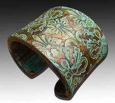 Best use of polymer I've seen in a long time. Brocade copper and patina polymer clay cuff by adrianaallenllc.