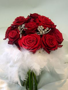 Red rose brooch bouquet with feathers