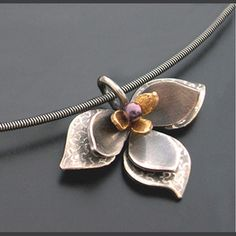 """Aileen Lampman     """"Lotus Pendant"""" layered in sterling, 14k and purple cultured pearl. Strung on a 16"""" sterling cable neck wire (pictured) or scalloped chain."""