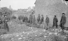German prisoners captured by Canadian troops of 1st Battalion, North Shore Regiment, Langrune-sur-Mer, 7 June 1944.