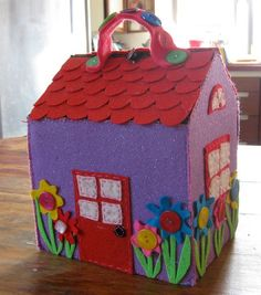 similar to the felt house I made for my niece.  I like the roof on this one.