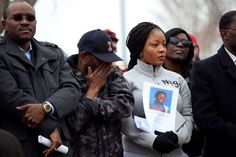 FILE- In this March 23, 2015, file photo, Barway Collins' father, Pierre Collins, wipes away tears as he stands with his wife, Yamah, and supporters at vigil in Crystal, Minn. for their missing son. A body found in the Mississippi River over the weekend has been identified as that of the 10-year-old Minnesota boy, Barway Collins, who has been missing for nearly a month, the police said Sunday, April 12, 2015.