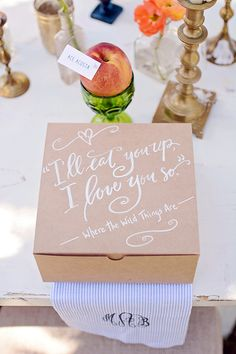 Where the Wild Things are quote in calligraphy on a wedding favor box. I LOVE this! Thanks #southernweddingmagazine.