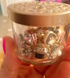 Use the mini candle containers from Bath & Body Works when they're empty for earrings or other storage containers!! Cute lid! :)