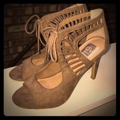 Dolce Vita strappy heels Beige strappy lace up heels / sandals. Super cute for spring. Excellent condition only worn once for a wedding. Dolce Vita Shoes Heels