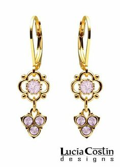 Flower Shaped Dangle Earrings Designed by Lucia Costin with Lilac Swarovski Crystals and Dots, Adorned with 3 Stones Dangle; 24K Yellow Gold over .925 Sterling Silver Lucia Costin. $33.00. Mesmerizing enough to wear on special occasions, but durable enough to be worn daily; Dangle earrings beautifully designed by Lucia Costin; Dangle ornaments accented with floral design; Adorned with light purple Swarovski crystals; Unique jewelry handmade in USA