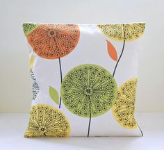 This lovely 16 inch (40 cm) decorative pillow cover has citrus lemon yellow, orange and green apple / lime dandelion flower heads and leaves on a