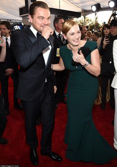 Together again: Best Supporting Actress nominee Kate shared a laugh with her Titanic co-star Leonardo DiCaprio