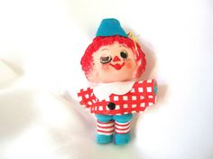 Vintage Christmas ornament Raggedy Andy. The plastic ornament has a molded head…