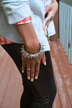 Plaid with spiked arm candy, and leggings with faux leather detail #ThisIsStyle #shop