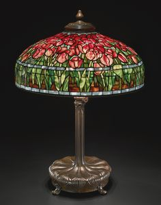 "Tiffany Studios New York ""Tulip"" leaded glass and patinated bronze table lamp."
