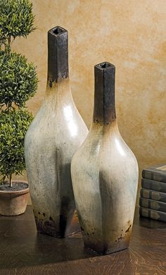 Valdez Terracotta Vases - Set of 2 - In a perfect blend of traditional Mexican terracotta finish and modern silhouette, this set of two vases are both beautiful and stylistically versatile. (IMAX)