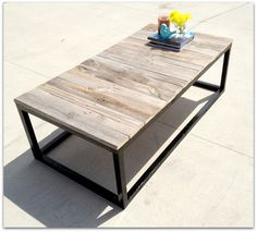 Coffee table made out of black painted 2 x 2's and topped with pallet boards from an old pallet.