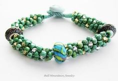 Green Gold and Silver Beaded Kumihimo Bracelet Lampwork