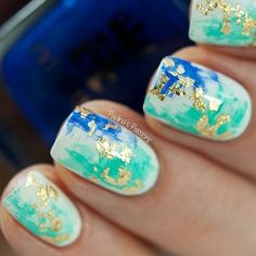 Turquoise and Cobalt Blue Nails With Gold Leaf Accents