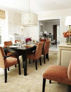 I like these orange chairs. would look good with a light grey curtains if you keep your current wall color