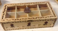 Wood box, stained, wood burned (freehand), lined with felt, accented with resin pine cones.