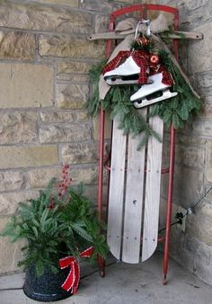 Christmas front porch idea. Replace the white skates for hockey skates and then it's perfect.