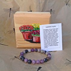 Soothing lepidolite with another hand painted box. Reminds me of the mums in the fall but with the hope of the coming spring. http://ift.tt/1Il1xda  :)  #handmadechristmas #gift #gifts #giftidea #giftideas #handmadegifts  #christmas #yule #Kwanzaa #Hanukkah #birthday #birthdaygift