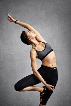 Nike women's SS15 - grey sports bra, black tights and Nike Studio Wrap shoes
