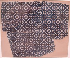 Fragment Date: 13th–14th century Geography: India Culture: Islamic Medium: Cotton; block-printed and resist-dyed Accession Number: 30.112.37