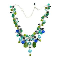 With a fashionable clustered pendant of fused glass in green and blue, this necklace will lend you that ideal touch of style. The attractive necklace is handcrafted with silver metal.
