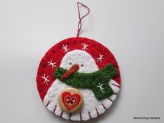 Snowman Ornament, Wool Felt, Christmas Green Scarf, Wood Button, Handstitched Snowflakes. $10.50, via Etsy.