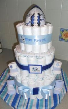Get ready for the NFL season! This creative Dallas Cowboys diaper cake is a really fun theme and a great example of customizing a diaper cake to the interests