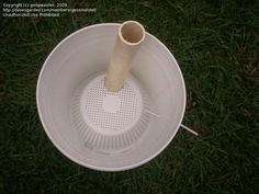 """5 gal bucket, upside down colander, pipe fitted through top of colander, & a straw to vent overflow. Add soil and plant and you have a """"self-watering"""" planter with about a 1 gal reservoir at the bottom."""